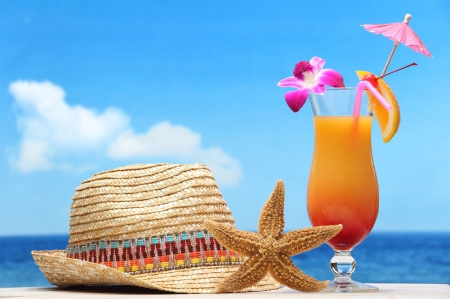 image of summer hat and cocktail